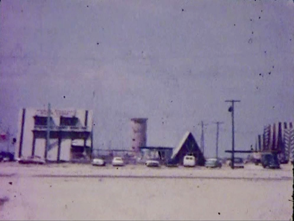 3. 1962-post hurricane. Nomad Village pre-bar. A-frames returned to foundations. Admiral Road looking North to WWII tower.